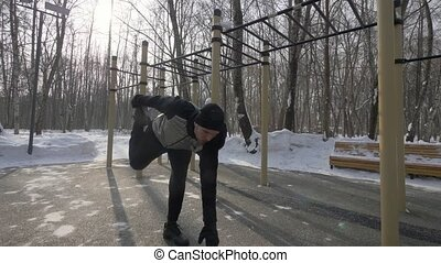 Young man training workout exercise on winter sports ground....