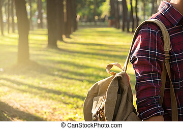Young Man Traveler with backpack relaxing outdoor on background Summer vacations and Lifestyle hiking concept.