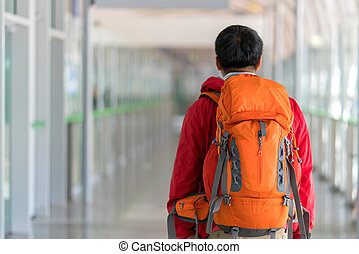Young man traveling backpacker with Backpack in city concept