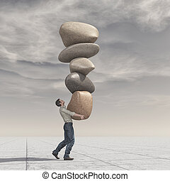 Young man up a pile of stones in balance