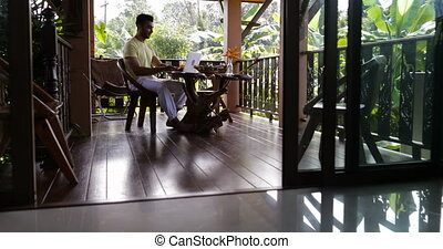 Young Man Use Laptop Computer On Terrace Happy Smiling Sitting At Table Outdoors Hispanic Guy