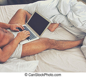 young man using a laptop at home