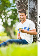 Young man using cell phone