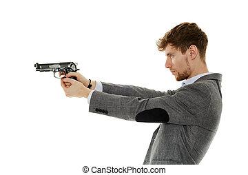 Young man using handgun