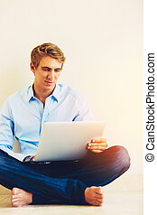 Man Using Laptop Working from Home