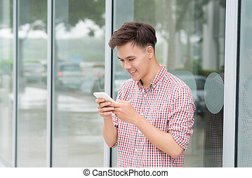 Young man using mobile phone at outdoor