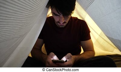 Young Man Using Smartphone Late at Night