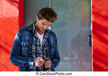 Young man using smartphone outdoor