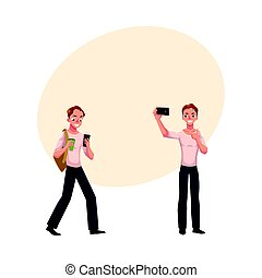 Young man using smartphone walking, making selfie with mobile phone