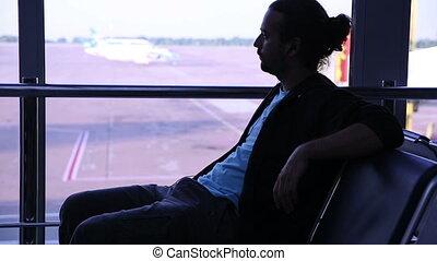 young man waiting his flight