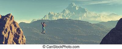Young man walking in balance