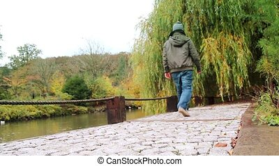 young man walking in park forest