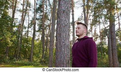 Young Man Walking in the Forest