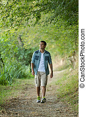 young man walking in the park