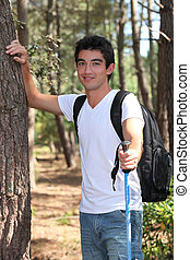 Young man walking in the woods