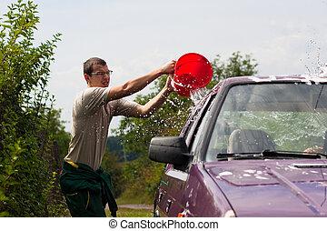 Young man wash car