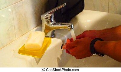 Young Man Washing Face - Young Man Washing His Face as Part...