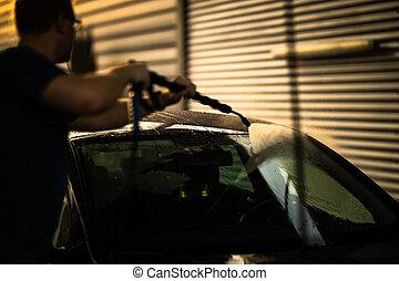 Young man washing his beloved car