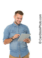 Young man watching a tablet pc, smiling