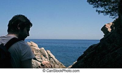 Young man watching horizon