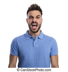 Young man wearing a light blue polo shouting out loud