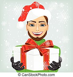 Young man wearing a santa hat offering a gift