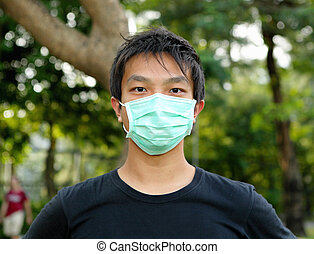 young man wearing face mask