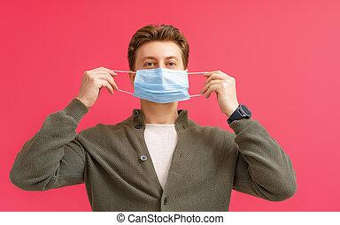 man wearing facemask - Young man wearing facemask during ...