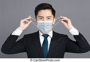 young man wearing medical mask