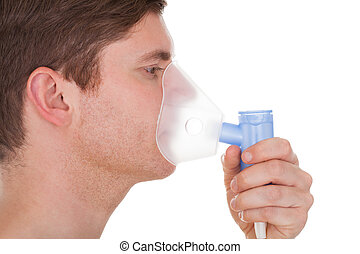 Young Man Wearing Oxygen Mask