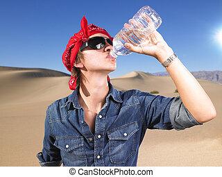 Young Man Wearing Sunglasses and Bandana Drinking Water