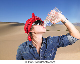 Young Man Wearing Sunglasses and Bandana Drinking Water