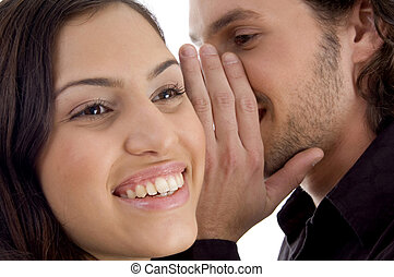 young man whispering to woman