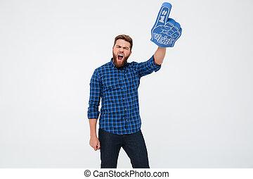 Young man winner showing fan finger isoloated