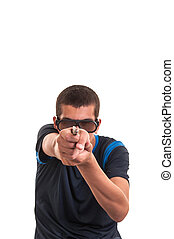 young man with 3d glasses is pointing a weapon at camera for fun