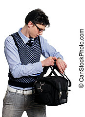 young man with a bag of looking at the watch
