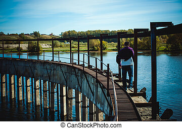 young man with a beard. a trip to the lake, an abandoned old dam, a warm sunny day