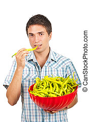 Young man with a bowl full of pepper
