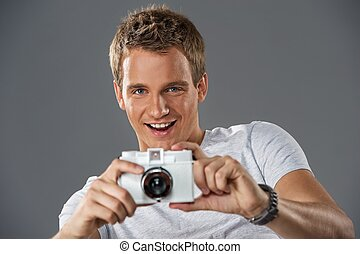 Young man with a camera