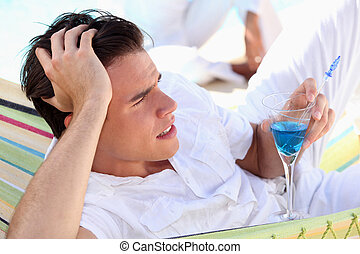 Young man with a cocktail
