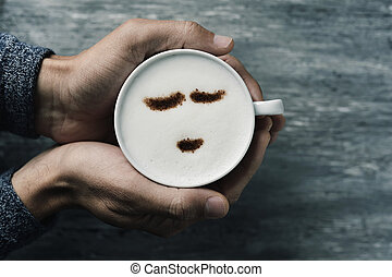 young man with a cup of cappuccino