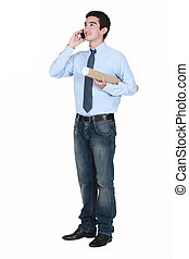Young man with a document tube and cellphone