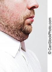 young man with a double chin - the result of poor lifestyle...