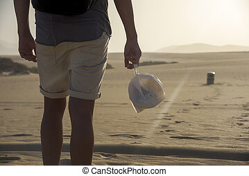 young man with a garbage bag