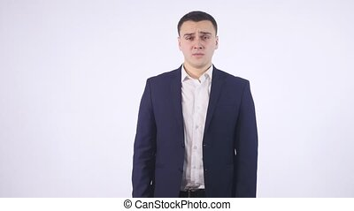 Young man with a gesture of disgust on white background