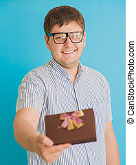 man with a gift box in hands