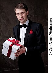 Young man with a gift box.