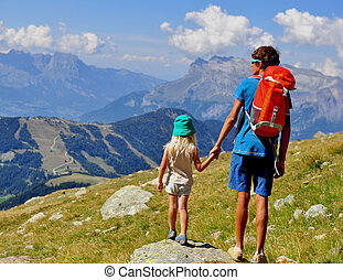 Young man with a kid in mountains