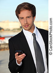 Young man with a mobile phone