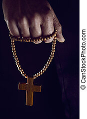 young man with a rosary in his hand